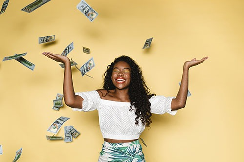 Woman throwing up cash
