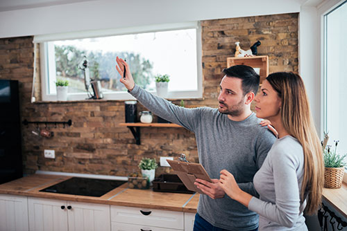 Couple looking at kitchen